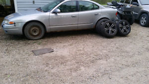 01 Olds alero 4 winter tires on and 4 summer tires on rims