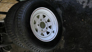 pair of 12 inch 5 bolt,  rims w tires