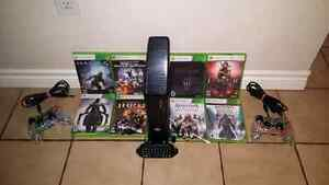 Xbox 360 with games controllers and accessories
