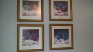 All 4 picture frames with pictures of fruit.