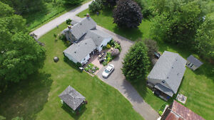Imagine the Possibilities! 35 Acre Estate with Guesthouse!