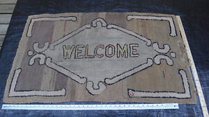 """Antique hooked rug with 'Welcome"""" Motif."""