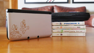 Nintendo 3DS XL (Year of Luigi) + 4 Games + Carrying Case