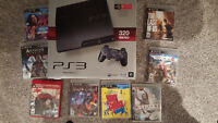 1 yr old PS3 for sale with 8 games and 1 controller