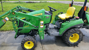 John Deere 1023 with front loader and rotatiller