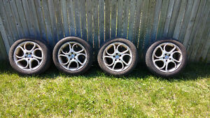 4 michelin hydroedge tires on 4 american racing rims