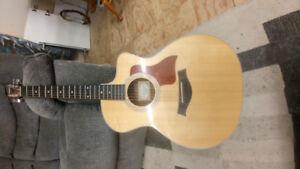 214ce DLX Taylor guitar