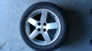16 in. Original mags and summer tires from pontiac pursuit