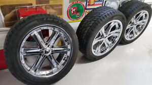 Four 20 inch custom wheels and tires