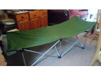 Camping gear. Folding single bed.