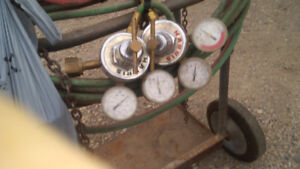 Welding cart with hose + guages.