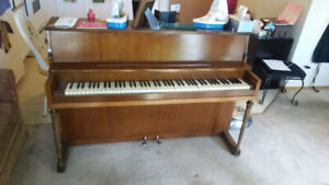 Apartment sized piano. Free