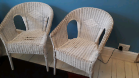 2 white wicker chairs