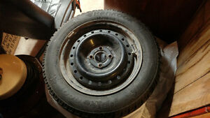 Selling 4 15in studded winter tires on rims