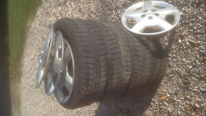 snow tires on rims with wheel covers 225/60/R17 London Ontario image 1