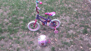 Girls 12 inch bicycle and helmet Peterborough Peterborough Area image 1