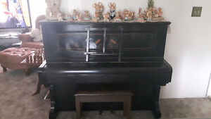 Black upright iron grand piano