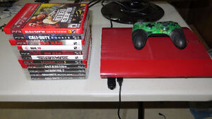 EXCELLENT RED PS3 500GB WITH 4 GAMES AND CONTROLLER