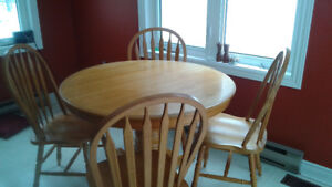 Oak Dining table with 4 chairs.