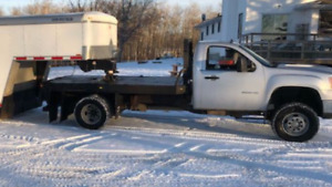 "2011 GMC 3500 reg cab flat deck 4"" lift"