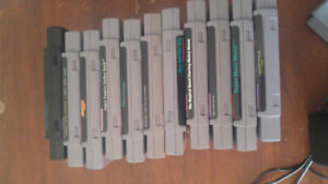 MINT* Super Nintendo With Stack of Games.