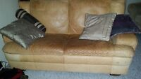Leather Couch with complimentary throw pillows on sale