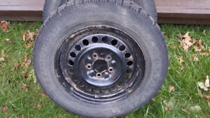Set of four 215/60R15 winter tires + steel rims in good shape