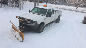 2003 f-350 4x4 5.4  gas with fisher plow.