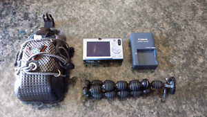 Camera with tripod, charger and case
