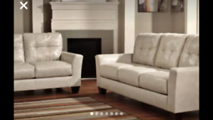 Taupe couch and loveseat