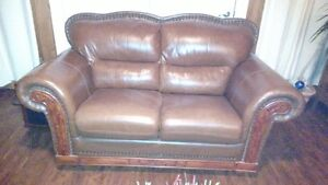 Beautiful 2 seater brown leather sofa. excellent condition