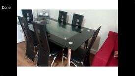 Nearly new 6 seater glass dining table