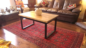 Reclaimed industrial metal base and solid wood top coffee table