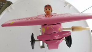 Vintage Tin Pink Wind-up Training Airplane MS011