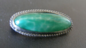 ANTIQUE JADE AND STERLING PIN