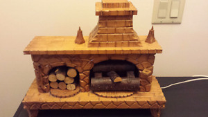 Hand carves folk art fireplace
