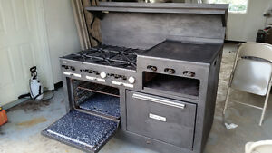 gas range with 2 ovens,  $2,000 OBO. 6 burners and a side grill