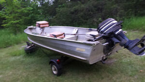 14 ft aluminum with 20 horse merc and trailer and trolling motor