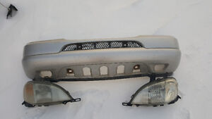 Front bumper cover and headlights
