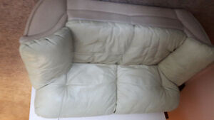 Tan lether love seat and couch