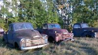 Three late forties Chevrolet trucks