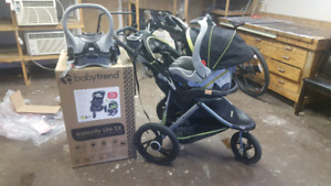 baby trend stroller, car seat and base.