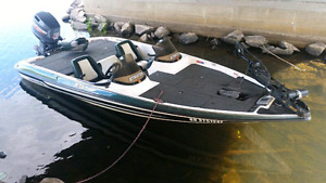TRIMMED OUT BOATS CARPETING FIBERGLASSING CUSTOM TOPS AND SEATS