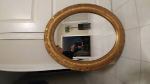 """Gold leafed Mirror 36 x 29"""" oval."""