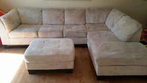 Beige micro suede sectional with ottoman for sale