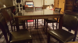 Dining table and 6 bar height chairs