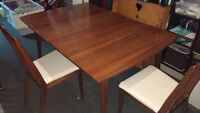 Oak veneer finished dining room table with two chairs. two leaf