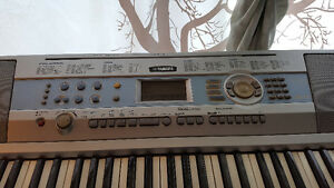 Piano yamaha portable grand DGX-200