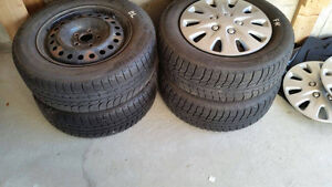 Excellent condition 4 Michelin X-ice winter tires with rim