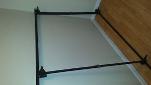 "BED FRAME.NO WHEELS BUT THERE NOT NEEDED. FITS 39""- 54"" BED. $20"